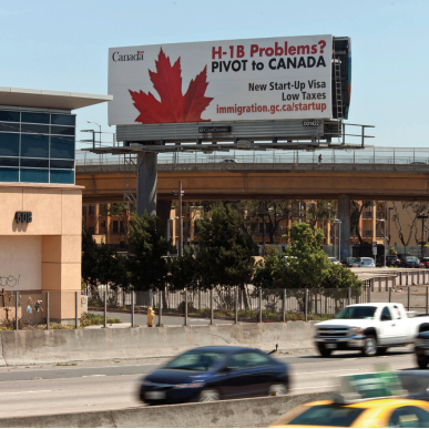 Canadian billboard seeks workers in U.S. with H-1B problems